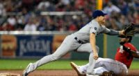 Los Angeles Dodgers second baseman Kiké Hernandez receives a throw against the Boston Red Sox