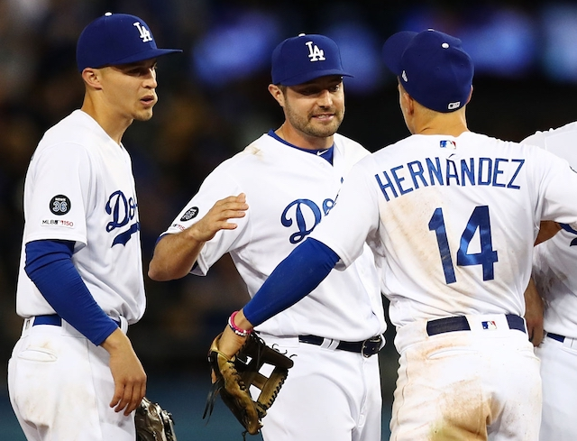 Kiké Hernandez, A.J. Pollock and Corey Seager celebrate after a Los Angeles Dodgers win