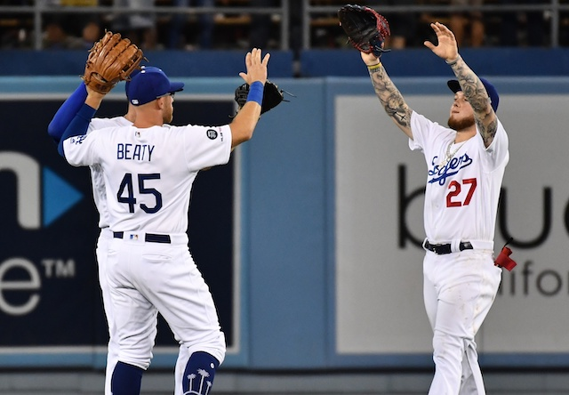 Outfielders Matt Beaty, Alex Verdugo celebrate after a Los Angeles Dodgers win