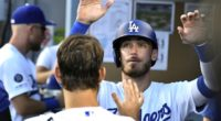 Cody Bellinger is congratulated by Clayton Kershaw in the Los Angeles Dodgers dugout