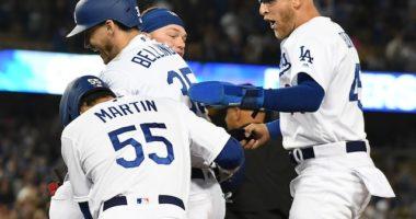 Matt Beaty, Cody Bellinger, Russell Martin and Alex Verdugo after a Los Angeles Dodgers walk-off win against the Arizona Diamondbacks