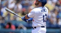 Los Angeles Dodgers infielder Max Muncy watches a home run at Dodger Stadium