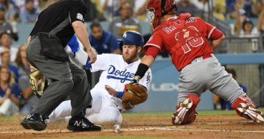 Los Angeles Dodgers first baseman Max Muncy is out at home plate