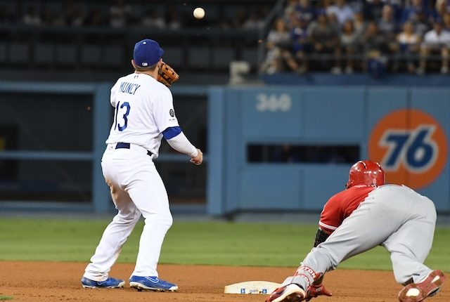 Los Angeles Dodgers infielder Max Muncy receives a throw at second base
