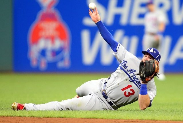 Los Angeles Dodgers infielder Max Muncy makes a diving stop during the 2019 MLB All-Star Game at Progressive Field