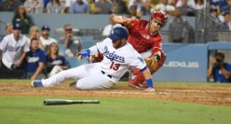 Los Angeles Dodgers first baseman Max Muncy scores a run