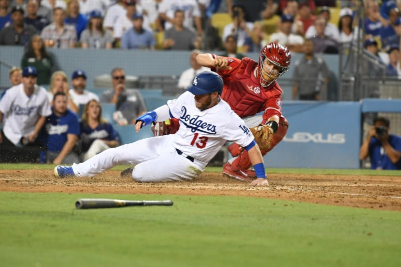 Los Angeles Dodgers first baseman Max Muncy scores a run