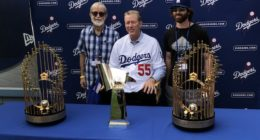 Orel Hershiser poses with World Series trophies during 2018 Dodgers All-Access at Dodger Stadium