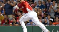 Boston Red Sox third baseman Rafael Devers hits a double against the Los Angeles Dodgers