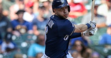 Milwaukee Brewers outfielder Ryan Braun hits a triple against the Atlanta braves