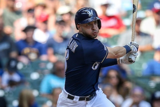 Milwaukee Brewers outfielder Ryan Braun hits a triple against the Atlanta braves