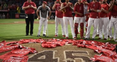 Los Angeles Angels of Anaheim players place their Tyler Skaggs jerseys on the mound after throwing a combined no-hitter against the Seattle Mariners