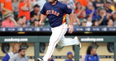 Houston Astros infielder Tyler White scores a run