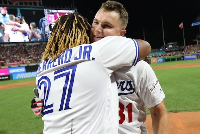 Toronto Blue Jays third baseman Vladimir Guerrero Jr. and Los Angeles Dodgers outfielder Joc Pederson embrace during the 2019 Home Run Derby at Progressive Field