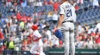 Los Angeles Dodgers pitcher Walker Buehler reacts after allowing a home run to Washington Nationals second baseman Brian Dozier