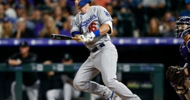 Los Angeles Dodgers catcher Will Smith hits a double against the Colorado Rockies