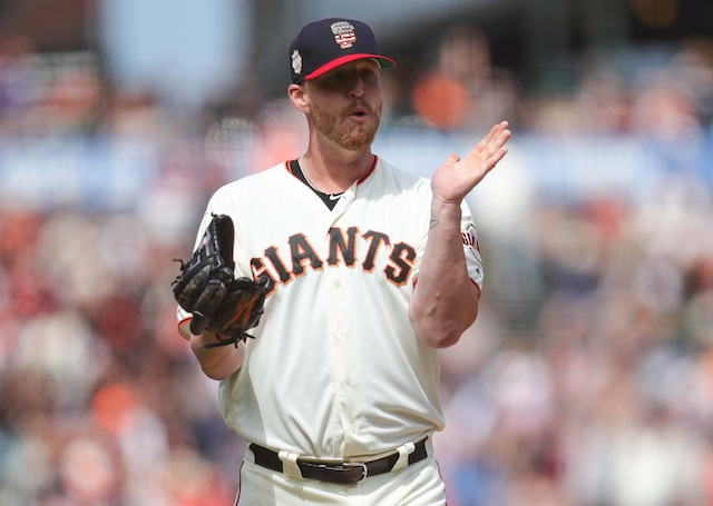 San Francisco Giants closer Will Smith reacts after converting a save