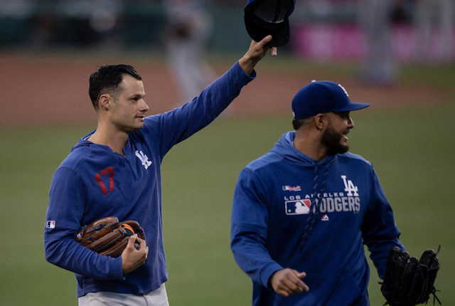 Los Angeles Dodgers relief pitcher Joe Kelly gestures to the crowd while walking out to the bullpen at Fenway Park