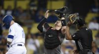 Los Angeles Dodgers center fielder A.J. Pollock reacts after being hit by a pitch