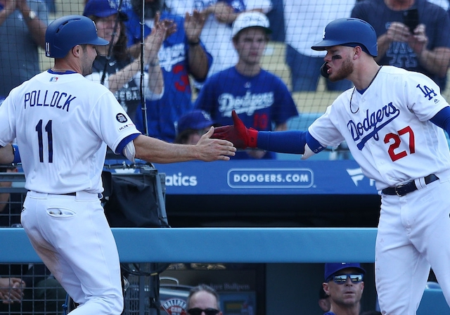 Los Angeles Dodgers outfielders A.J. Pollock and Alex Verdugo celebrate at Dodger Stadium
