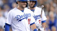 Los Angeles Dodgers teammates A.J. Pollock and Chris Taylor react