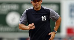 New York Yankees manager Aaron Boone runs off the field at Yankee Stadium
