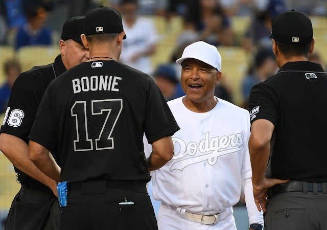 New York Yankees manager Aaron Boone and Los Angeles Dodgers manager Dave Roberts with umpires before a game at Dodger Stadium