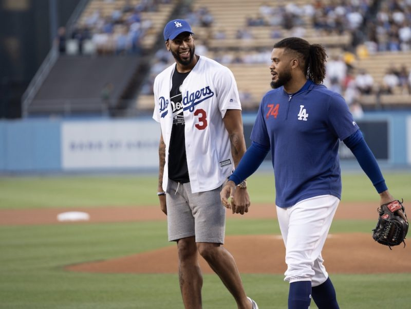 Los Angeles Dodgers closer Kenley Jansen walks off the field with Anthony Davis after he threw out the first pitch on Lakers Night at Dodger Stadium