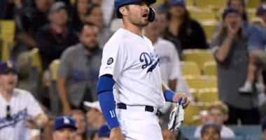 Los Angeles Dodgers center fielder A.J. Pollock reacts to Arizona Diamondbacks pitcher Archie Bradley