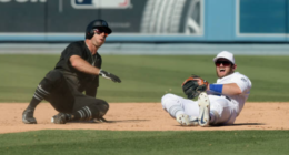 New York Yankees center fielder Brett Gardner slides into Los Angeles Dodgers infielder Max Muncy