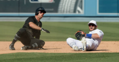 New York Yankees center fielder Brett Gardner slides into Los Angeles Dodgers infielder Max Muncy