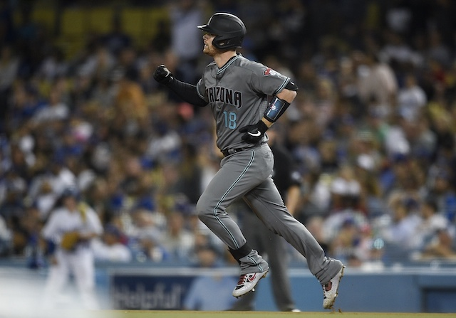 Arizona Diamondbacks catcher Carson Kelly rounds the bases after hitting a home run against the Los Angeles Dodgers