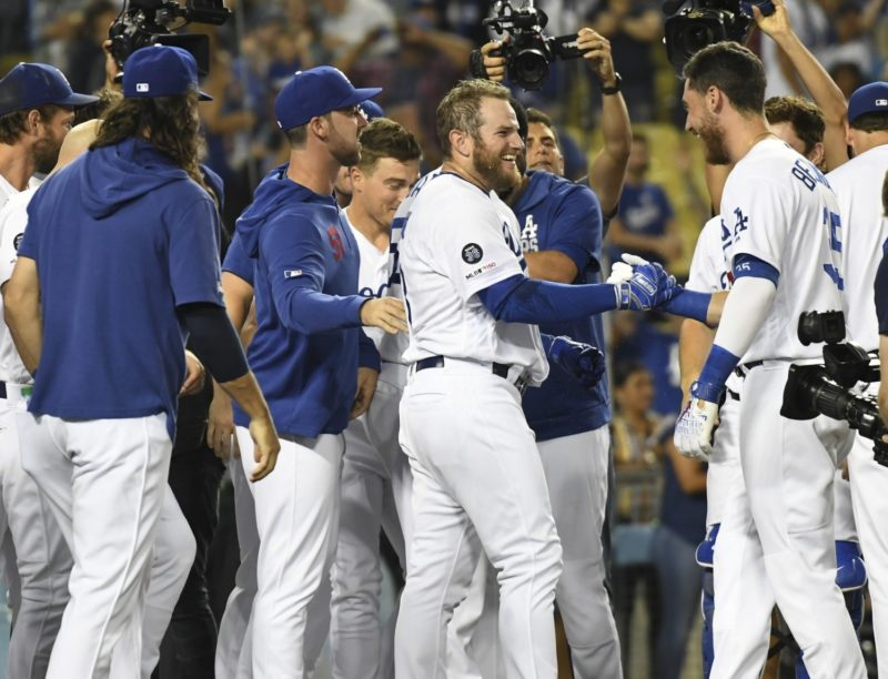 Los Angeles Dodgers teammates Cody Bellinger, Dylan Floro, Kiké Hernandez, Clayton Kershaw and Max Muncy celebrate after a walk-off win