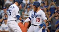 Los Angeles Dodgers teammates Cody Bellinger and Justin Turner celebrate after a home run