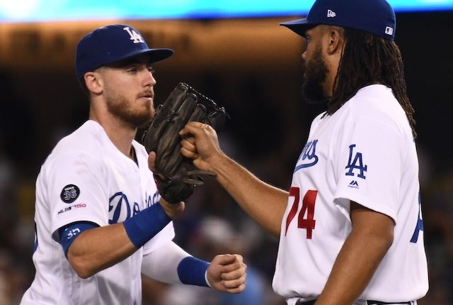 Cody Bellinger and Kenley Jansen celebrate after a Los Angeles Dodgers win