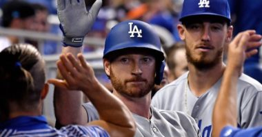 Los Angeles Dodgers All-Star Cody Bellinger congratulates Kyle Garlick in the dugout after a home run