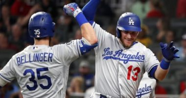 Los Angeles Dodgers teammates Cody Bellinger and Max Muncy celebrate after hitting a home run