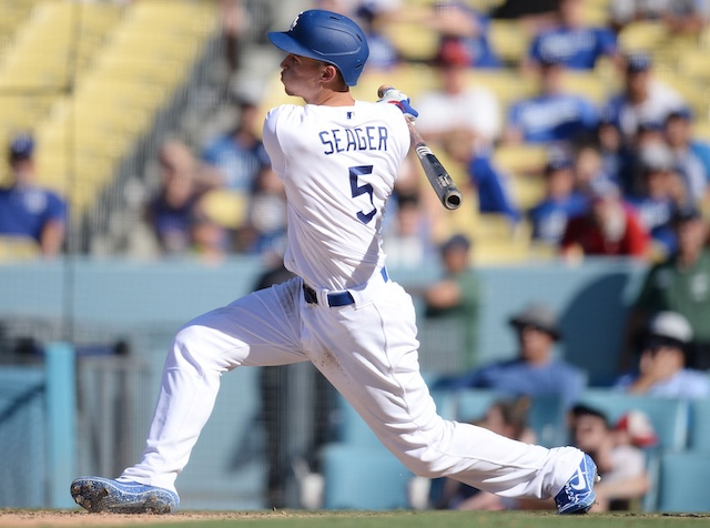 Los Angeles Dodgers shortstop Corey Seager reaches on an error