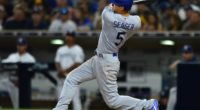 Los Angeles Dodgers shortstop Corey Seager hits a double against the San Diego Padres