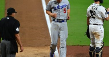 Los Angeles Dodgers shortstop Corey Seager scores a run against the San Diego Padres