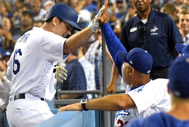 Los Angeles Dodgers manager Dave Roberts congratulates Will Smith after his grand slam against the San Diego Padres