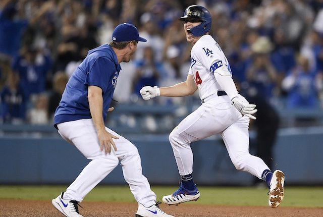David Freese and Kiké Hernandez celebrate a Los Angeles Dodgers walk-off win