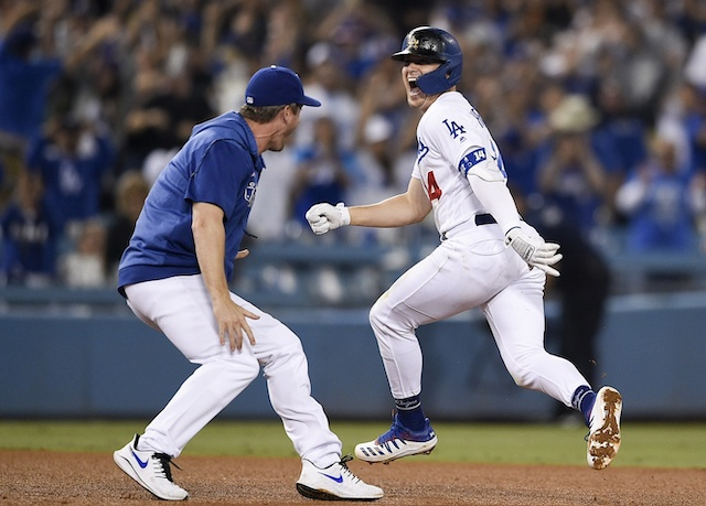 David Freese and Kiké Hernandez celebrate a Los Angeles Dodgers walk-off win