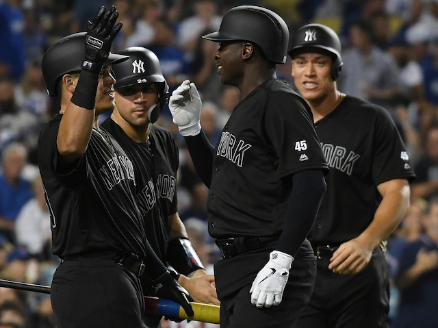 New York Yankees teammates DiDi Gregorious, Aaron Judge and Gary Sanchez celebrate after a grand slam