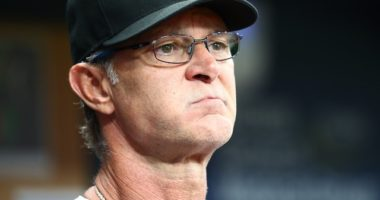 Miami Marlins manager Don Mattingly looks on from the dugout