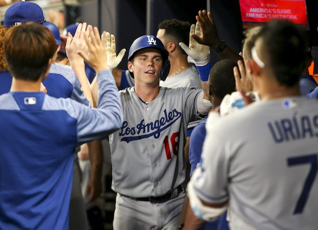Will Smith is congratulated by Los Angeles Dodgers teammates after hitting a home run