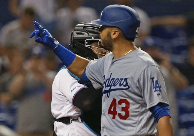 Los Angeles Dodgers infielder Edwin Rios reacts after hitting a home run
