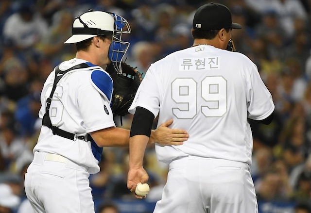 Los Angeles Dodgers catcher Will Smith has a mound visit with Hyun-Jin Ryu