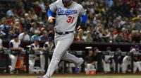Los Angeles Dodgers outfielder Joc Pederson scores a run against the Arizona Diamondbacks