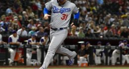 Los Angeles Dodgers outfielder Joc Pederson scores a run against the Arizona Diamondbacks
